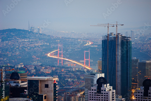Aerial view of the Istanbul city downtown with skyscrapers at night Poster