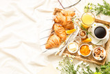 Continental breakfast on white bed sheets - flat lay - 176089932