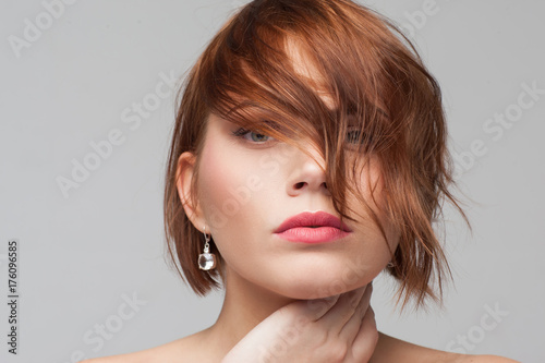 Keuken foto achterwand Kapsalon Female hairstyle advertising. Ashamed introvert. Beautiful tender woman portrait closeup. Modern fashion look, young girl with clean skin on grey background
