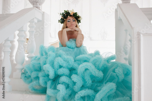 Plakát Beautiful young girl in cloud dress