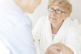 Senior woman looking at caregiver - 176099309