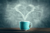 Cup of coffee with a heart shaped steam