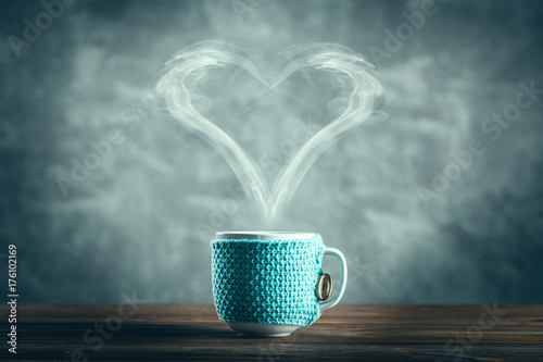 Cup of coffee with a heart shaped steam - 176102169