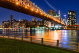 Evening view of Manhattan Midtown East from Roosevelt Island with the illuminated Ed Koch Queensboro Bridge and the East River. New York City - 176105578