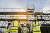 Civil engineer and safety officer in spec steel truss structure scaffolding risk analysis in construction site - 176105748