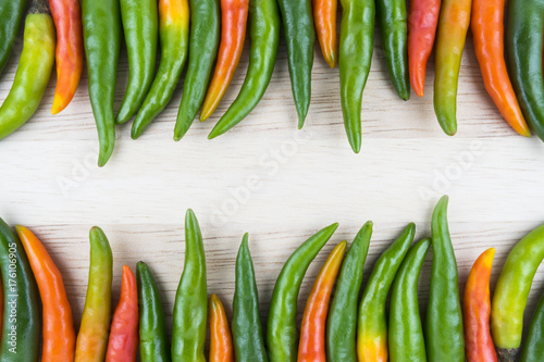 Foto op Aluminium Hot chili peppers Hot Chilli Peppers isolated on wood board background, close up. Selective focus