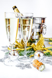 glasses of champagne and Christmas ornaments on white background - 176107519