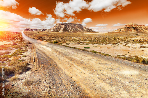 Keuken foto achterwand Beige Beautiful desert sunset and road landscape .Sunset scenic. Travel and adventures through remote panoramic desert landscape