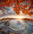 Alexandre III bridge in Paris against Eiffel Tower with autumn leaves, France