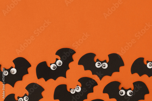 Halloween bat character shape with funny googly eyes - 176135128