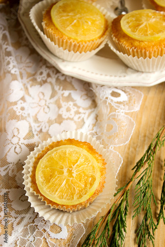 Lemon muffins with lemon slices, festive decoration with a fir branches Poster