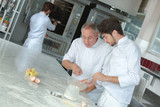 chef and apprentice making pastry - 176149159
