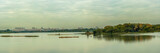 panoramic view of a large urban reservoir with an island and a modern residential area on the opposite coast