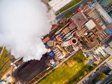 Aerial view to smoking chimmney from lignite power plant. Air pollution and climate change theme. Heavy industry from above.  - 176157568