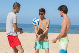smiling adults throwing ball and laughing