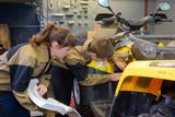 fixing a quad bike - 176159547