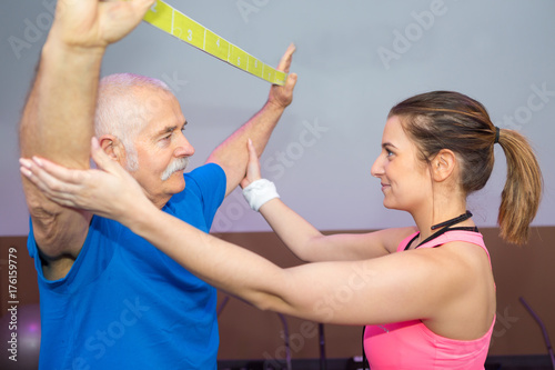 Fotobehang Fitness personal-trainer working out with elastic band man training