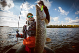 Fishing. Fisherman and trophy Pike. - 176169180