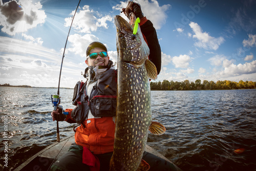 Fishing. Fisherman and trophy Pike. Poster