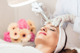 Close-up of the face of a woman relaxing during non-surgical facelift treatment in a contemporary beauty salon with innovative technology - 176170734