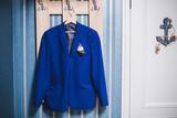 men's jacket on a hanger in the room - 176171300