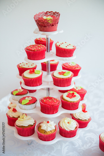 Cupcakes on the plates on the table Poster