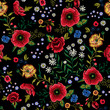 Embroidery traditional seamless pattern with red poppies and roses.