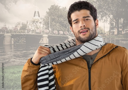Man wearing scarf and coat in city