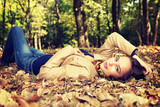 Young  girl relaxing in autumn park - 176175919