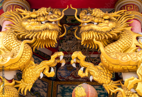 Gold dragon statues in Chinese religious venues