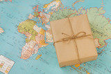 International shipping. Cardboard box on the geographical map background - 176188133