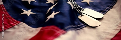 Dog tag chains on flag Poster
