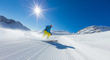 Young man skier running down the slope in Alpine mountains - 176210533