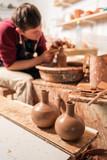 Potter at work. Workshop. - 176210984