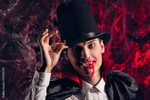 handsome man dressed in a Dracula costume for Halloween. Poster
