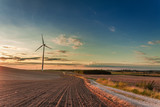 Amazing dusk at field with wind turbine in autumn - 176212573