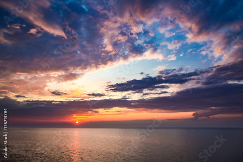 Fotobehang Strand Beautiful dusk over calm ocean in summer