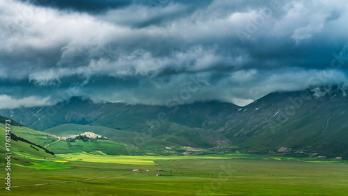 Papiers peints Bleu vert Dramatic sky and valley in Castelluccio at summer, Umbria, Italy
