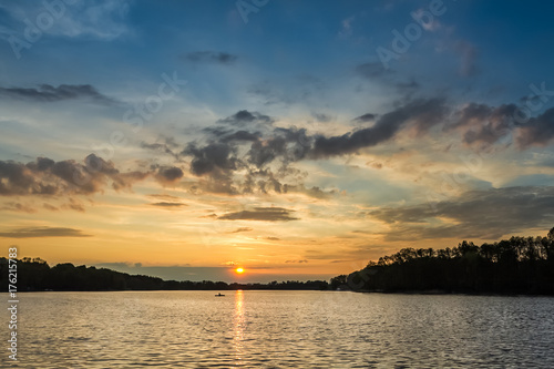 Fotobehang Zomer Stunning sunset at the lake with alone boat in summer