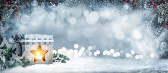 Christmas background with lantern, fir branches and bokeh lights