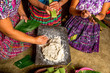 Quadro San Pedro la Laguna, Guatemala: Mayan women in traditional wear preparing food together