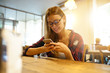 Girl in coffee shop connected with smartphone
