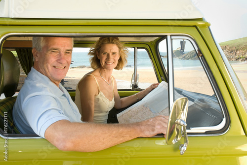 Mature couple in camper van Poster