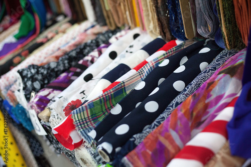 Colorful rolls of clothing textile - 176227586