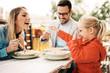 Leinwandbild Motiv Family enjoying pasta