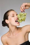 female beauty eating grapes - 176231720