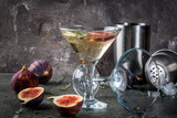 Fall and winter drinks recipes, Martini cocktail with fig, thyme and honey, on black stone table, copy space - 176233385