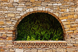 arch in the old stone wall - 176242383