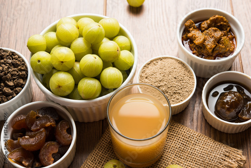 In de dag Sap Stock photo of Amla/Avla/Aavla and it's by products like chyawanprash or chyavanprash, juice, Amla supari or mouth freshner, powder, juicy or dried sweet murabba or muramba, pickle, selective focus