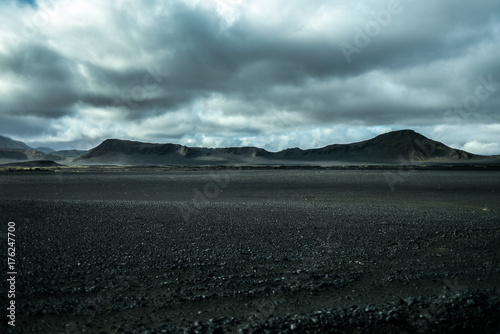 Staande foto Grijze traf. Lunar landscape of Iceland, endless volcanic areas and mountains in the background.